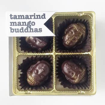 """An award-winning flavor that happens to be vegan. Tangy, fruity tamarind mango ganache with organic, fair-trade dark chocolate.  All-natural, fair trade cocoa, non-GMO, soy-free. 4pc box. 3.5"""" x 3.5"""" x 7/8"""" Shelf life: 6 months with proper storage (in an air-conditioned environment away from light & heat)."""
